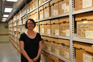 WAM Files Archivist Heather Carroll in the University Archives.